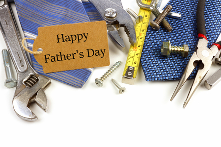 Happy Fathers Day gift tag with border of tools and ties on a white background Stock Photo