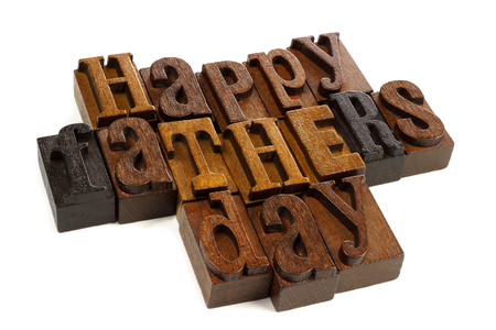 Happy Fathers day vintage wooden letters against a white background