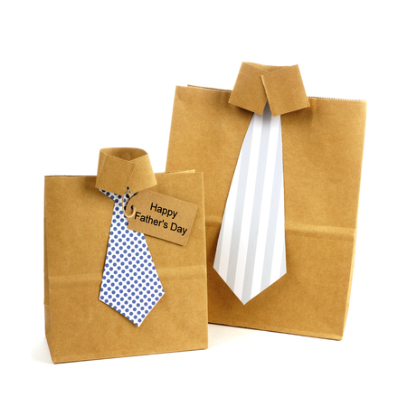 Fathers Day handmade shirt and tie gift bags with greeting card on a white background Stock Photo