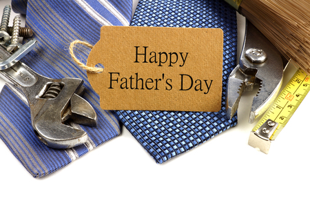 Happy Fathers Day gift tag with border of tools and ties against white