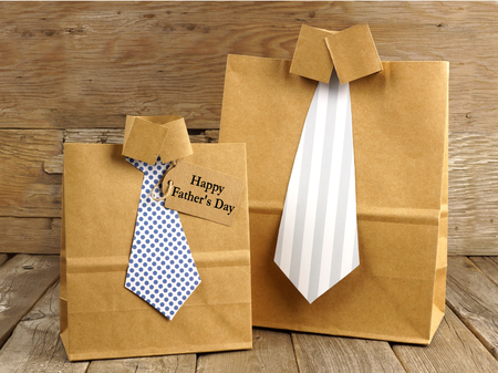 father's: Fathers Day handmade shirt and tie gift bags with greeting card on a wood background