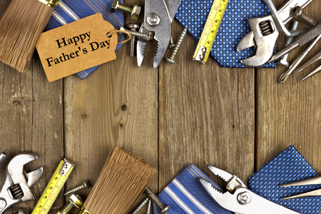 father's: Happy Fathers Day gift tag with double border of tools and ties on a rustic wood background