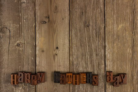 Happy Fathers Day vintage wood letters on a rustic wooden background Stock Photo