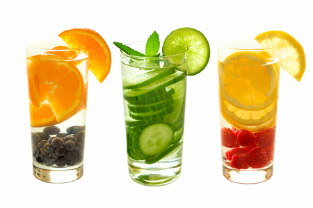 types of glasses: Three types of nutritious detox water with fruit in glasses isolated on a white background