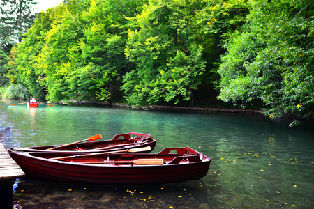 plitvice: Boats docks in the tranquil waters of Plitvice Lakes National Park Croatia
