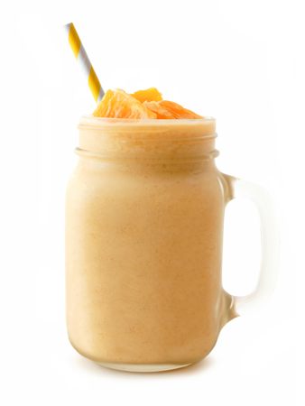 jars: Orange smoothie in a mason jar glass with striped straw isolated on a white background