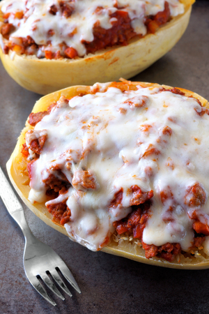 Close up of spaghetti squash baked with lean ground turkey tomato sauce and melted mozzarella cheese