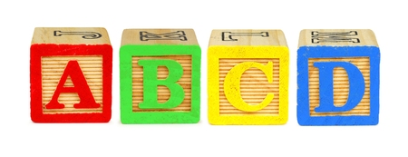 yellow block: A B C D wooden toy letter blocks isolated on white Stock Photo