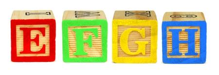 letter blocks: E F G H toy wooden letter blocks Stock Photo