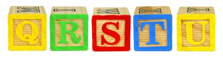 q: Q R S T U wooden toy letter blocks isolated on white Stock Photo