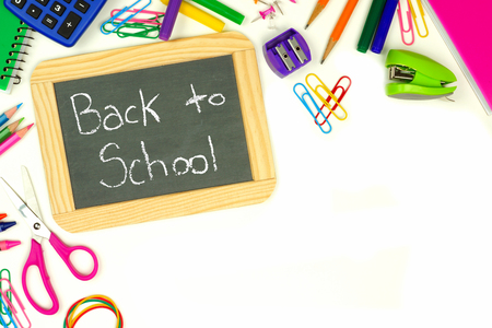 white back: Back to School chalkboard on a white background with school supplies corner border Stock Photo