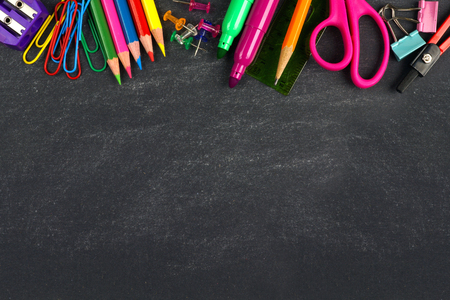 School supplies top border on a chalkboard background Zdjęcie Seryjne - 42849413