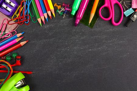 School supplies top corner border on a chalkboard background