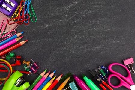 School supplies bottom corner border on a chalkboard background