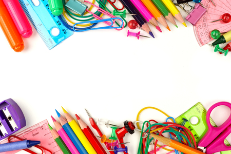 Double border of colorful school supplies on a white background