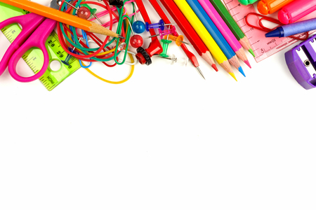 Top border of colorful school supplies on a white background