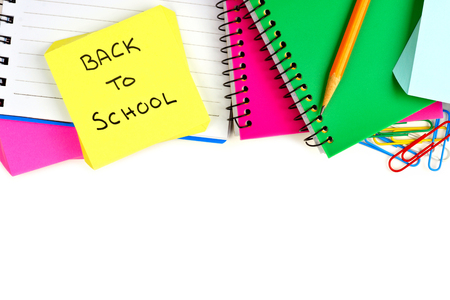white back: Border of colorful school supplies with Back to School note pad on a white background