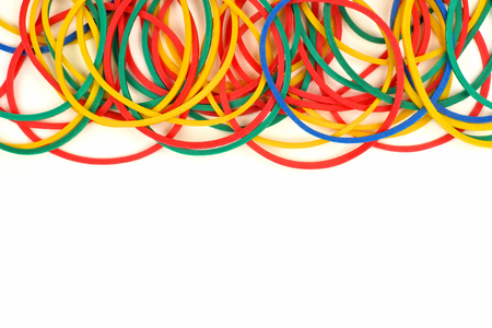 school band: Top border of colorful elastic rubber bands over a white background Stock Photo