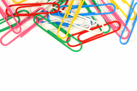 paperclip: Top border of colorful paper clips over a white background