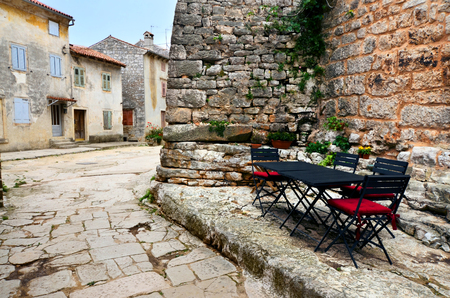 restaurant tables: Restaurant tables and chairs in a cobblestone lane in Istria, Croatia