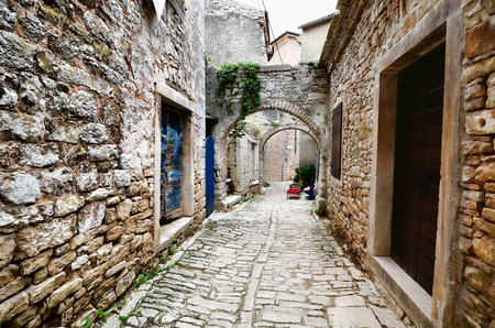 arched: Arched medieval street in a European village Stock Photo