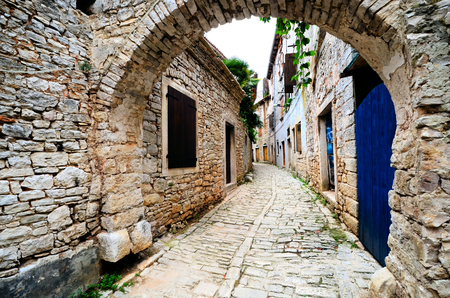 alley: Ancient arched medieval street in an old village in Istria, Croatia