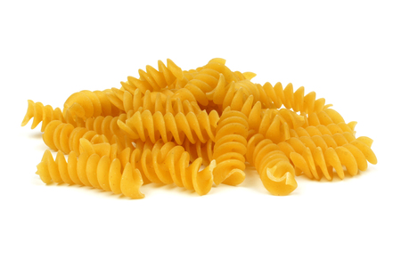 semolina pasta: Pile of uncooked dry rotini pasta isolated on a white background