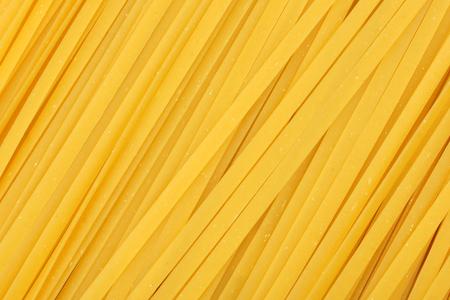 linguine pasta: Full background of dried uncooked linguine pasta