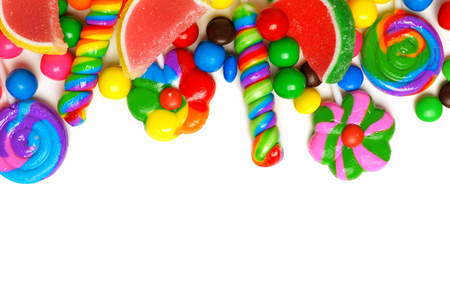 swirl background: Top border of an assortment of colorful candies against a white background