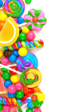 gumballs: Side border of an assortment of colorful candies against a white background