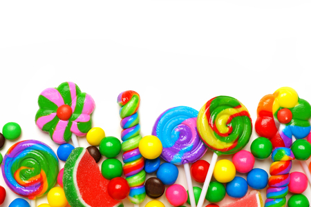 Bottom border of an assortment of colorful candies against a white background