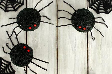 wood spider: Halloween spider cupcake corner border on white wood background Stock Photo