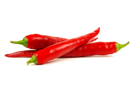 Group of red hot peppers isolated on a white background