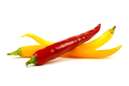 chili: Group of mixed hot peppers isolated on a white background
