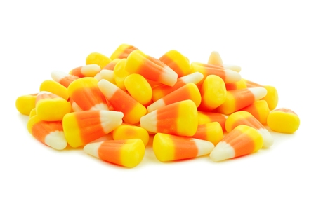 Pile of Halloween candy corn over a white background 免版税图像