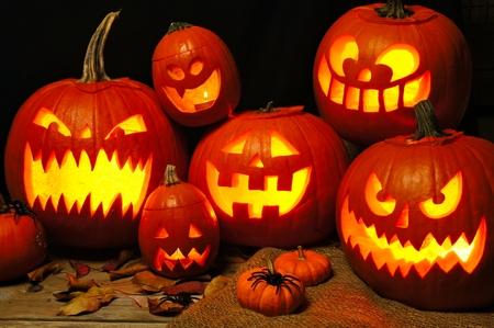 Halloween night scene with a group of spooky illuminated Jack o Lanterns