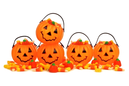 arrangment: Halloween Jack o Lantern candy holders with scattered candy