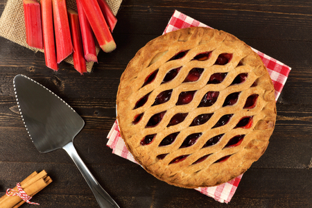strawberry: Sweet strawberry and rhubarb pie overhead scene on a dark wooden background