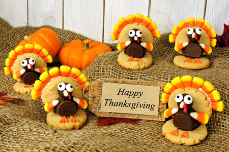 Group of turkey shaped cookies with Happy Thanksgiving card on burlap