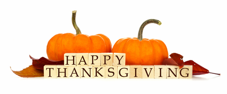 happy holidays text: Happy Thanksgiving wooden blocks with pumpkins and autumn leaves isolated on white