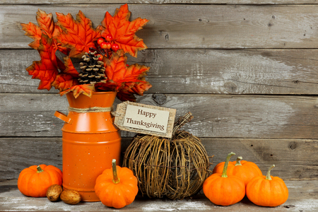 Happy Thanksgiving tag pumpkins and autumn home decor with rustic wood background