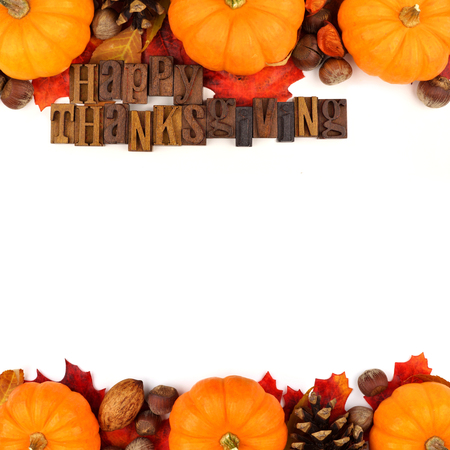 thanksgiving harvest: Happy Thanksgiving wooden letterpress with autumn double border of pumpkins, leaves and nuts isolated on white Stock Photo
