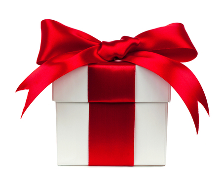 White gift box wrapped with vibrant red bow and ribbon isolated on white
