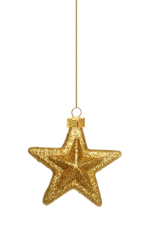 Single hanging gold star Christmas ornament isolated on white
