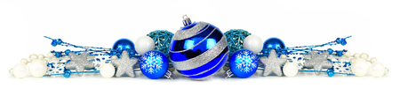 Christmas border of blue and silver ornaments and branches isolated on a white background