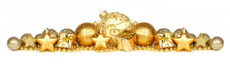 group of christmas baubles: Christmas border of gold ornaments presents and beads isolated on a white background