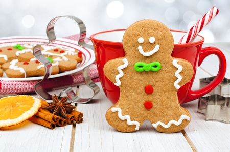 wood cutter: Christmas gingerbread man cookie table scene with hot chocolate and twinkling silver background