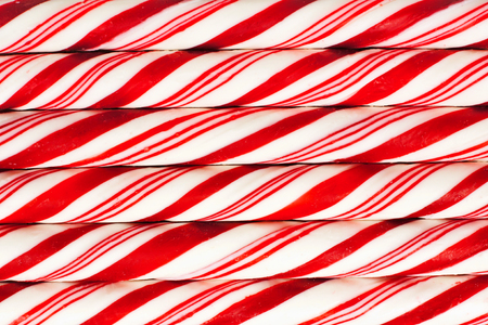 Full background of red and white striped Christmas candy canes Stock Photo