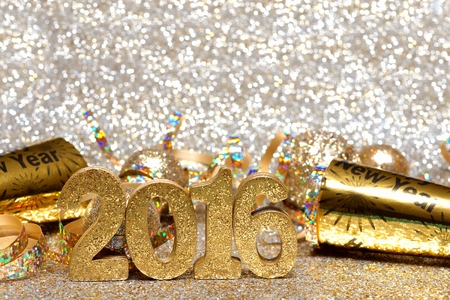 holiday maker: New Years Eve 2016 golden numbers and decorations with twinkling light background
