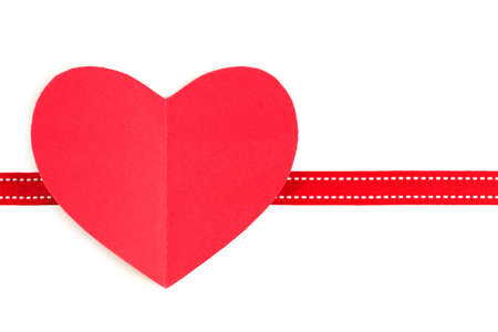 folded paper: Valentines Day paper heart with fold over white with red ribbon border Stock Photo